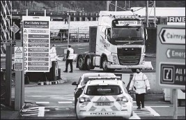 ?? THE ASSOCIATED PRESS ?? Customs officials check vehicles at the P&O ferry terminal in the port at Larne, Northern Ireland. The Brexit split is predicted to impact the Northern Ireland border.