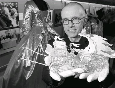 ?? PHOTOS BY WAYNE CUDDINGTON,THE OTTAWA CITIZEN ?? Retiring NAC archivist Gerry Grace shows off a model of Henry Bardon's design for Cinderella's carriage, built in 1979 for the opera Cendrillon. It's one of his favourite pieces from the collection of memorabilia kept in the National Arts Centre's...
