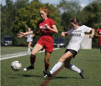 ?? MARY scHwALm pHOTOs / bOsTON HeRALD ?? GETTING IT ROLLING: Hingham's Cara Chipianelli, left, and Wellesley's Ella Martin compete for the ball during the girls soccer jamboree on Saturday in Medway. Below, Hingham's Claire Murray fouls Wellesley's Rory Claire as she tries to make a play.