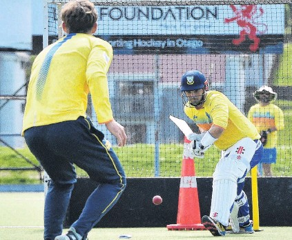 ?? PHOTO GREGOR RICHARDSON ?? Bit of a road . . . Otago batsman Anaru Kitchen plays a defensive shot to a delivery from Michael Rippon on the artificial turf at Logan Park yesterday.