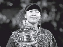 ?? LOREN ELLIOTT/REUTERS ?? Naomi Osaka is 12-0 in Grand Slam quarterfinals, semifinals and finals after a 6-4, 6-3 victory over Jennifer Brady on Saturday.