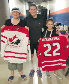 ?? HOCKEY CANADA ?? Sheryl Sadorski, left, and Emily Gordon, right, met Hayley Wickenheiser and other Team Canada stars at the Sandman Centre.
