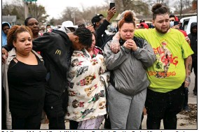 ?? (AP/Star Tribune/Aaron Lavinsky) ?? Relatives and friends of Daunte Wright grieve Sunday in Brooklyn Center, Minn., hours after he was fatally shot by a police officer.