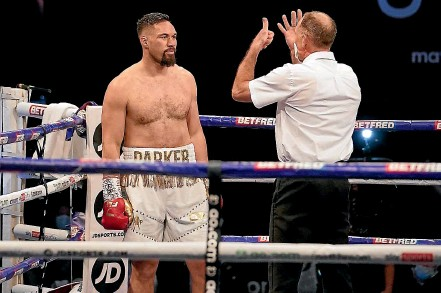 ??  ?? Joseph Parker takes an eight count in round one against Derek Chisora.