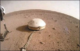 """?? NASA ?? THE InSight lander snapped this photo of its shielded seismometer instrument on the surface of the red planet this month. """"This is the opening round of Mars seismology,"""" Bruce Banerdt, InSight's principal investigator, said Tuesday."""