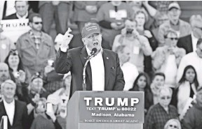?? SCOTT OLSON, GETTY IMAGES ?? Republican presidential candidate Donald Trump speaks Sunday at a rally at the Madison City Schools Stadium in Madison, Ala.