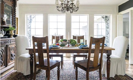 """??  ?? FOR THIS WALL IN THE DINING ROOM, Kim chose a dramatic black paint. """"It was kind of glam, and went with anything ... The little deer picture is from a garage sale, and the bigger frame was a flea-market find."""""""