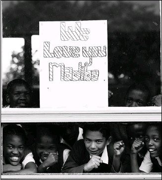 ?? Siphiwe Sibeko, Reuters ?? Children from a school adjacent to Milpark Hospital in Johannesburg show a placard wishing Nelson Mandela, also known by his clan name Madiba, a speedy recovery on Thursday.