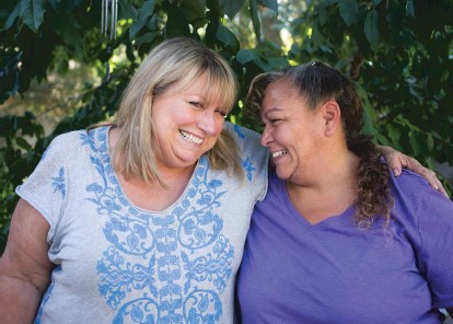 ?? PHOTOS BY OLIVIA HARLOW/THE NEW MEXICAN ?? Cheryl Alters Jamison, left, laughs with Lenore Tapia-Baker last month on the patio at Jamison's Tesuque home. They have been close friends since they first met 38 years ago via Big Brothers Big Sisters, when Jamison served as Tapia-Baker's mentor.