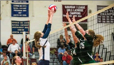 ?? RICK KAUFFMAN — 21ST CENTURY MEDIA ?? Bishop Shanahan's Rita Shultz, left, and Katie Quinlan go up to block Upper Merion's Nikki Carpenter during the District 1 Class AAA volleyball final at Abington High on Saturday.