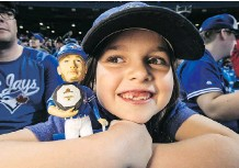 ?? CRAIG ROBERTSON ?? Harper Duffy, 10, was one of the lucky fans to get a Josh Donaldson MVP bobblehead doll at the Rogers Centre on Sunday.