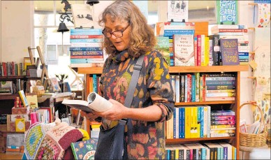 ?? PICTURE / PAUL BROOKS ?? Kirsty Powell reads from her book The Strength of Eggshells at Paige's Book Gallery last Friday.
