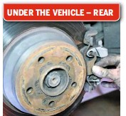 ??  ?? 24 RE­MOVE REAR BRAKES The rear brakes have some dif­fer­ences with the fronts. There are rub­ber caps on the back of both caliper bolts, which are T40 Torx items. After you've done the same clean­ing and checks as with the fronts, undo these. There's also a clip on the front pad that will need to be taken off.
