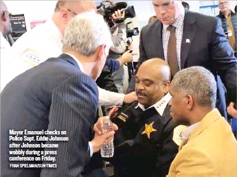 ?? FRAN SPIELMAN/ SUN- TIMES ?? Mayor Emanuel checks on Po­lice Supt. Ed­die John­son af­ter John­son be­came wob­bly dur­ing a press con­fer­ence on Fri­day.