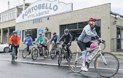 ?? PHOTO: GERARD O'BRIEN ?? Leading the way . . . Trish Rigby leads a group of cyclists on a sponsored ride for MS Otago from Portobello to the Otago Yacht Club and return yesterday.