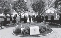 ?? Sub­mit­ted photo ?? Of­fi­cials and fam­ily mem­bers gather in the State­house Gar­den of He­roes on Wed­nes­day for an an­nual wreath-lay­ing. The event hon­ors the 28 Rhode Is­landers who have died in mil­i­tary ser­vice since Sept. 11, 2001.
