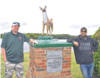 """?? SHARON MONTGOMERY-DUPE • CAPE BRETON POST ?? Jeff McNeil, left, of Scotchtown, president of the Port Morien Wildlife Association, stands with Brian """"Munchie"""" MacDonald, owner of New Waterford Recycling, by the new doe statue at the New Waterford Fish and Game Sportsmen's Memorial Park in River Ryan."""