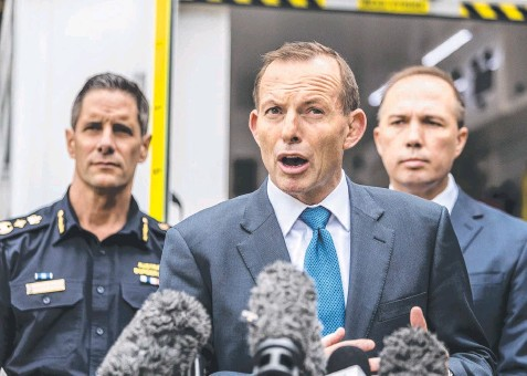 ??  ?? BOTCHES WITHOUT BORDERS: Roman Quaedvlieg from the Australian Border Force, Prime Minister Tony Abbott and Immigration Minister Peter Dutton weren't willing to accept responsibility for the Border Force announcement. Picture: AAP