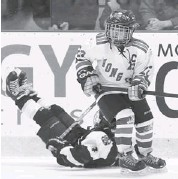 ?? JEAN LEVAC/OTTAWA CITIZEN ?? Yi Yamm of the Hong Kong Ice Scrapers looks for the puck during a major atom A division game at the Bell Sensplex Thursday. In the background, Trent Colling of the Peterborough Petes takes a tumble during the match.