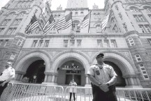 ?? ALEX BRANDON/ASSOCIATED PRESS ?? Guards stand outside the Trump Hotel in the District. The plaintiffs want to know which countries have spent money at the hotel.