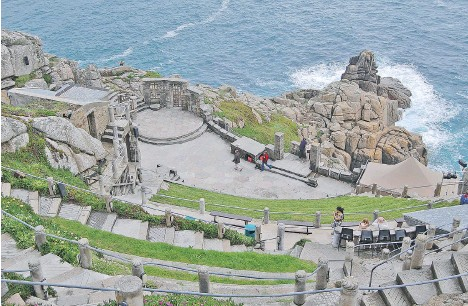 ?? CAMERON HEWITT ?? Carve out some time for a picnic or some cliff-hanging live drama at the open-air Minack Theatre.
