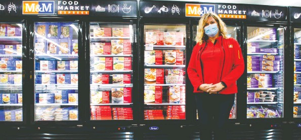 ?? Damon MacLean ?? Elmira Home Hardware owner Krista McBay has added an M&M Food Market Express section to her store.