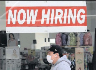 ?? THE ASSOCIATED PRESS ?? A CVS Pharmacy in San Francisco advertises that it has jobs available. Of the roughly 20million Americansnowreceiving jobless benefits, about half will lose the assistance at the end of the year.