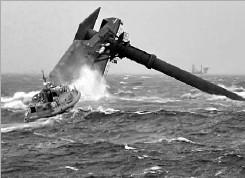 ?? U.S. Coast Guard Cutter Glenn Harris ?? A Coast Guard boat heads toward the capsized lift boat. The search for missing crew members continues.