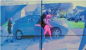 ?? AP ?? In an image from police bodycam video that the Columbus Police Department played during a news conference, a teenage girl, foreground, appears to wield a knife during an altercation before being shot by a police officer in Columbus, Ohio.