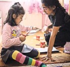 ?? LENA MUCHA FOR THE NEW YORK TIMES ?? Angela Al Abdi, left, the 5-yearold daughter of Hibaja Maai, is named after Angela Merkel, who let refugees into Germany.