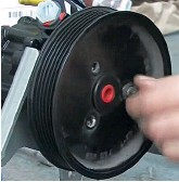 ??  ?? If required, clean the flange and swap the pulley between the old and replacement pumps, ensuring that the bolts are tightened to their specified torque and that you damage neither the pulley, nor pump body, as you do so. 12