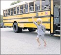 ?? DANIEL SANGJIB MIN/TIMES-DISPATCH ?? A Hanover County first-grader exited the school bus and ran to his mother after the first day of school in September. A handful of localities across the state added in-person learning options this week.