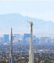 ?? AP ?? An Angel Moroni statue stands atop a spire on the Las Vegas Nevada Temple overlooking the Las Vegas Strip on Thursday. Air pollution in Las Vegas ranks among the worst in the country, according to a new report.