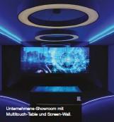 ??  ?? Unternehmens-Showroom mit Multitouch-Table und Screen-Wall.