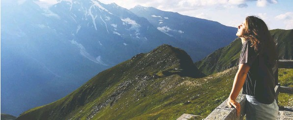 ?? — MaRy CHaRleson ?? After the isolation of the pandemic, `we will want to travel with eyes wide open, take a breath, savour slow travel, and go deeper,' Mary Charleson writes. Above, the writer's daughter at a view point along Grossglockner Road in Austria.