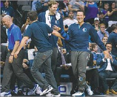 """??  ?? A laughing Tony Romo is pulled back by Mavericks owner Mark Cuban after some Mavs players had sent Romo in the direction of coach Rick Carlisle seeking to get him inserted into the game in the final minutes. """"This is an honor that I would never dream..."""