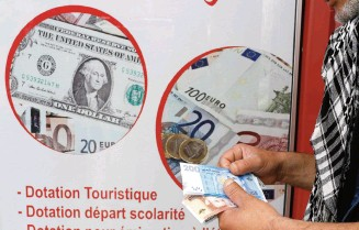 A Currency Dealer Counts Moroccan Dirhams In Photo Ilration At Exchange Point Casablanca Morocco