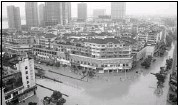 ?? AFP-Getty Images ?? a view of the flooded roads in Lanxi, zhejiang province, on Monday. heavy rains leave millions of people homeless and scores dead or missing in central and southern China.