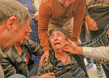?? (AFP) ?? A relative mourn during the funeral of a couple and their daughter killed in a rocket attack, in the city of Ganja, Azerbaijan, on Saturday