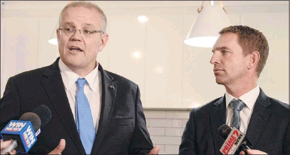 ?? PHOTO: Mel Guy ?? NOT THIS TIME: Former Indi candidate Steve Martin (right) with Prime Minister Scott Morrison in Wangaratta days before the 2019 election.