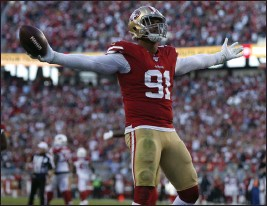 ?? NHAT V. MEYER — BAY AREA NEWS GROUP FILE ?? The San Francisco 49ers' Arik Armstead (91) celebrates his sack against the Arizona Cardinals in the fourth quarter at Levi's Stadium in Santa Clara on Nov. 17. The ball was ruled down.