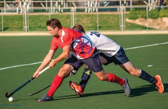 ?? Photo: Blake Linder ?? Jacques Potgieter gains control of the ball for Old Oaks during their game against Quarry in the regular season.