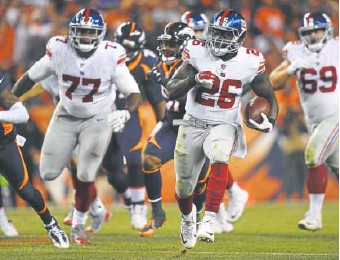 ?? Helen Richardson, The Denver Post ?? Orleans Darkwa helped the Giants pound Denver on the ground last weekend, contributing 117 of their 148 yards rushing in their 23-10 victory over the Broncos.