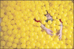 ?? Shaban Athuman/staff Photographer ?? Snap151 has a yellow ball pit — great for Instagram. The 4,500-squarefoot space at Mockingbird Station, in a former American Apparel store, features 10 backdrops for photographs.