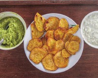 ??  ?? Simple, healthy snacks such as these sweet-potato chips with avocado and tzatziki dips are easy to make in a small galley.