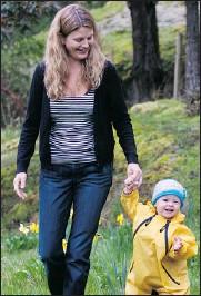 ?? — VICTORIA TIMES COLONIST ?? Savannah KromeDeering, in her waterproof suit, enjoys an outing with mom Tamara.
