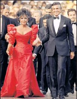 """?? By Michael Lipchitz, AP ?? 1987: Taylor hit Cannes with thenboyfriend George Hamilton dressed in a stand-out red gown with leg-ofmutton sleeves. """"I love the color. It's interesting she sort of went between having very pale skin to being very tan during her life,"""" Duke says...."""