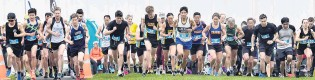 ?? PHOTO: PETER MCINTOSH ?? And they're off . . . Competitors at the start of the Otago 10km road championships yesterday. Nic Bathgate (Leith) won the senior men's title in 33min 52sec and Rebekah Green the senior women's title in 34min 58sec.