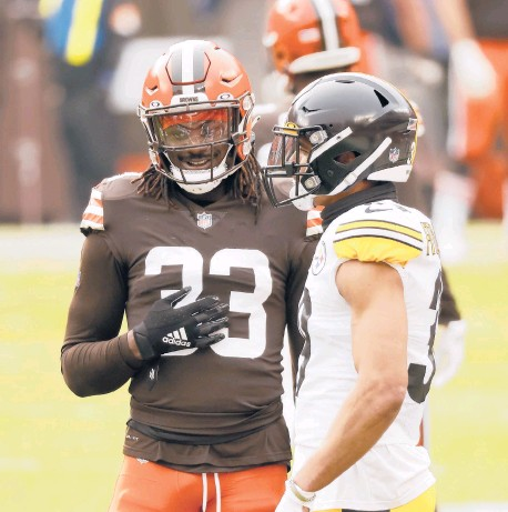 ?? KIRK IRWIN/AP ?? Browns safety Ronnie Harrison (33), pictured with Steelers safety Minkah Fitzpatrick, is one of three Browns players returning from the COVID-19 list for Sunday's game in Pittsburgh.