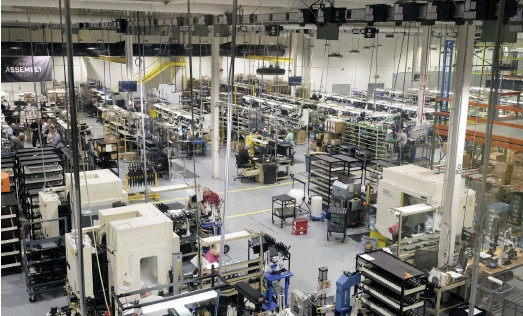 ??  ?? An overview of part of one of the SIG SAUER factories. The big white boxes are CNC machines. The ASP20 is assembled under the 'Assembly' sign, top left.